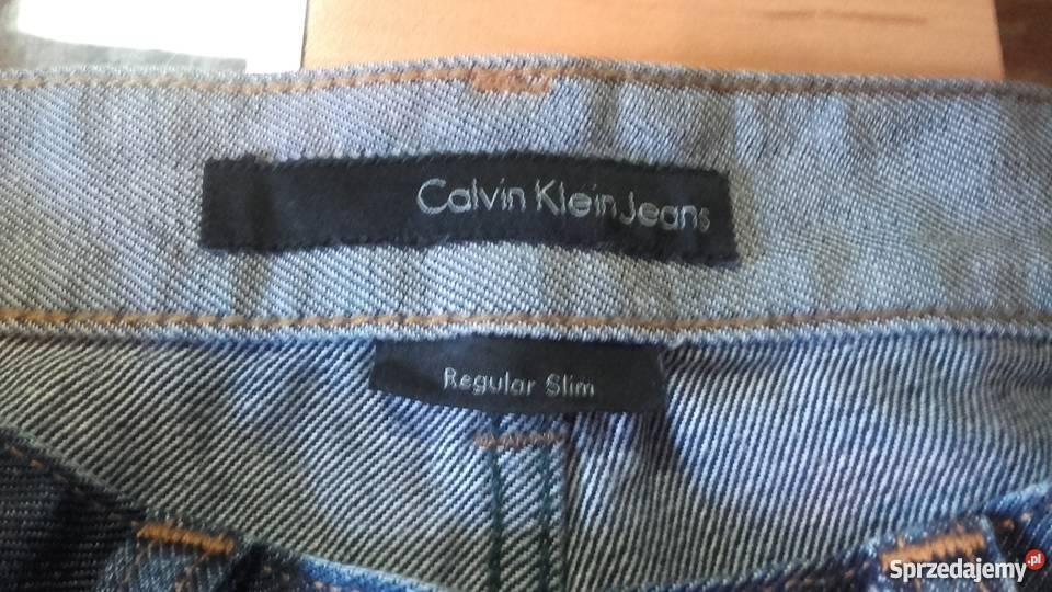 dzinsy Calvin Klein regular slim z dziurami