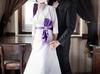 Elegancka biała suknia ślubna z fioletowymi dodatkami - miniaturka