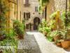 Fototapeta z uliczka z kwiatami i doniczkami Włochy SU237