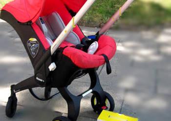 Mobilny fotelik samochodowy Doona do 13 kg
