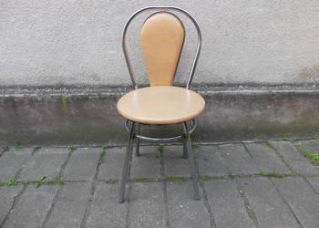 Krzesło tapicerowane na metalowej konstrukcji 473