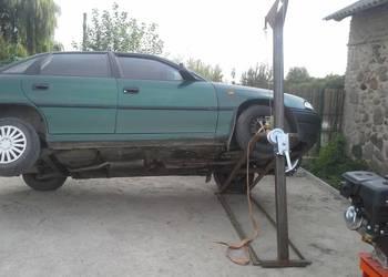 Podnośnik samochodowy przechyłowy kołyska