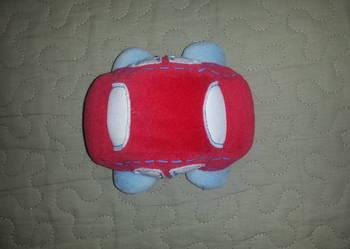 Mothercare czerwony samochodzik piszczałka